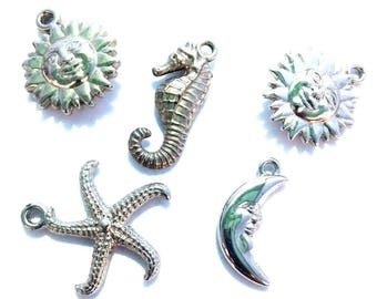 Small assortment of silver colored charms