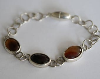 Silver bracelet with mounted stones
