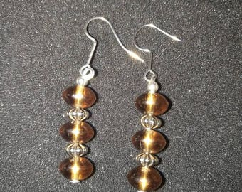 152. Dangling Silver Earrings