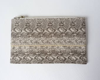 Elongated snake printed denim clutch, evening bag