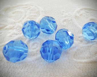 A set of 6 beads 12 mm blue faceted crystal.