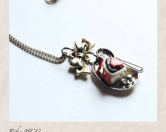 Short silver necklace with a part of Strawberry