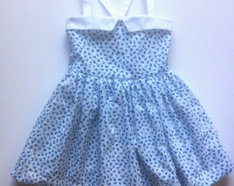 Dress little girl in broderie anglaise