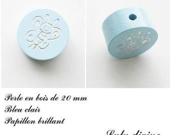 Wooden bead of 20 mm, flat Pearl light blue: Butterfly silver