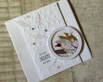 Handmade shaker greeting card with punched feathers.
