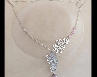 Necklace prints filigree flowers and glass beads
