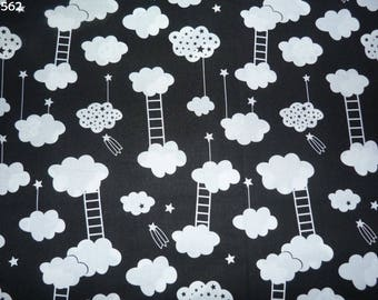 Fabric C562 white clouds on black coupon 50x50cm