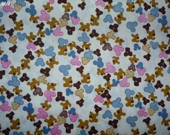 Coupon 35x50cm mickey heads and fabric C369 small dogs