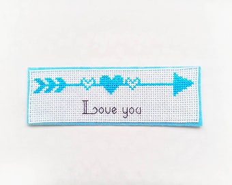 Embroidered bookmark reading love