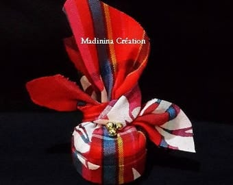 West Indian headdress in red and pink madras