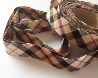 Through a Scottish Plaid tartan style red beige and black