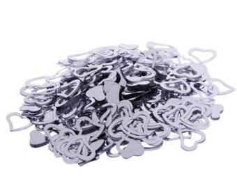 Silver heart confetti. table confetti