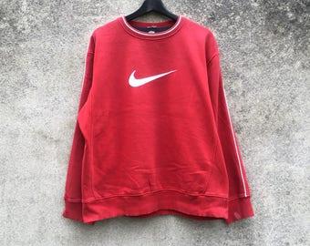 NIKE vintage 90s Nike big swoosh logo red colour simple design