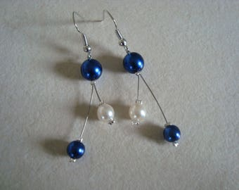 Blue and white dangling earrings