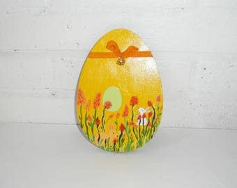 Egg shaped wooden wall decoration