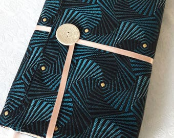 "Book adaptable large format, in turquoise blue ""spiral"" design, thick black cotton lining fabric."