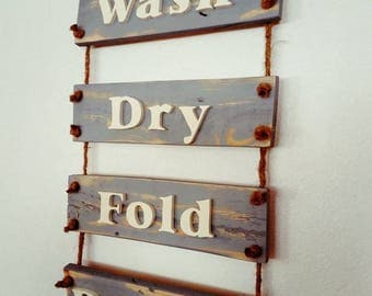 Wash, dry, fold, repeat laundry room pallet sign.