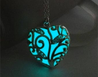 Blue statement glow in the dark heart pendant necklace