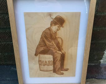 Charlie Chaplin!  An Engraving on birch plywood of an antique advertisement showing Charlie Chaplin.  Available Framed.