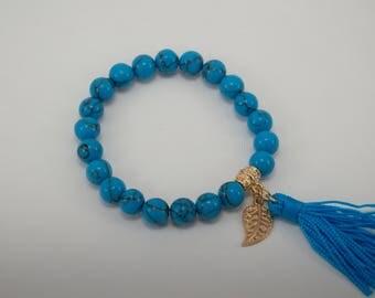 blue boho bracelet with tassel & leaf