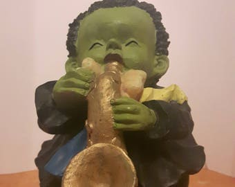 Ceramic figurine of a child street musician playing a trumpet!!!