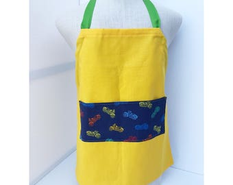 Adjustable apron with motorcycle pocket