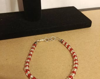 Red and silver tone beaded bracelet