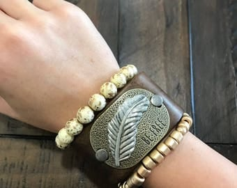 Brown leather band w/ BE FREE