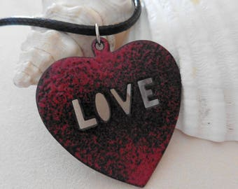 Pendant necklace covered with opaque enamel red heart spotted black, Inscription LOVE lace, black cord.
