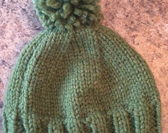 Green bulky hat with pompom
