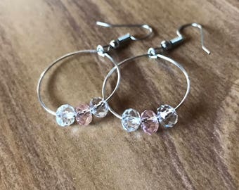 pink and white beaded hoops