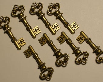 "8 Small Double Sided Bronze Keys 1 1/4"" in length & 1/2"" in width. DIY Crafts. Jewelry Supplies."