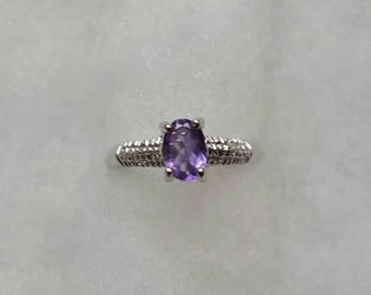 Adorable 0.7 carat genuine amethyst ring size 7, set in sterling silver