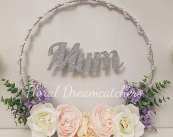 Floral hoop with Mum in silver glitter.
