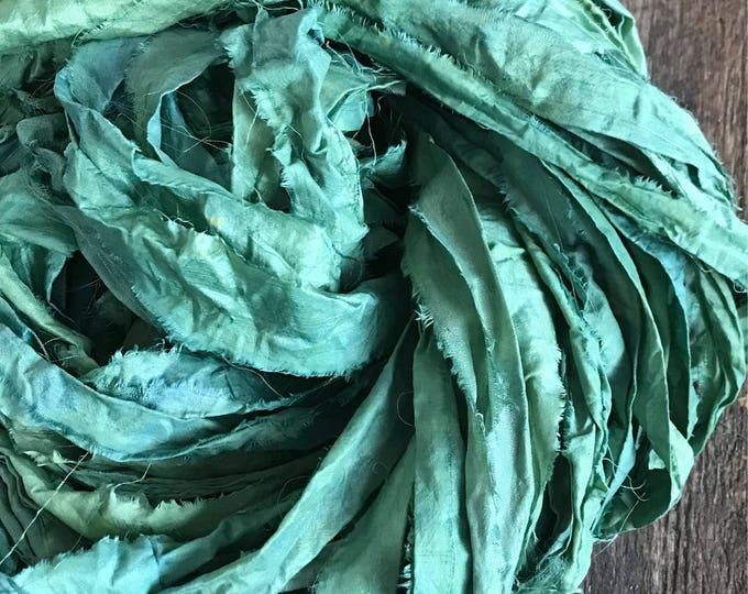 Indigo and eucalyptus dyed sari silk strip yarn, 50 yards, upcycled sari silk strips