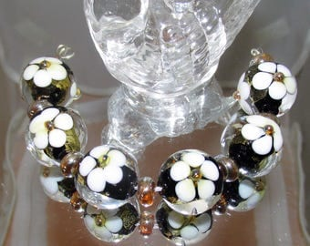 White Magnolias. Lampwork beads. 6, 18 mm rounds.