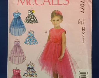 McCall's M7077 sewing pattern, Girls' Dresses US sizes 2 to 5