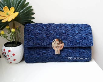 Blue crocheted clutch bag purse