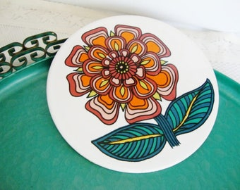 round tile with mod orange zinnia flower ceramic trivet 1960s