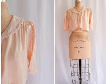1930s Lingerie | Dottie | Vintage 30s Bed Jacket Pale Pink Silk Charmeuse Mesh Collar and Ruffled Trim Embroidered Dots Ribbon Bow Closure