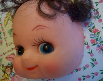 rubber doll head