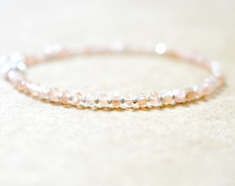 light African sunstone beaded bracelet. peachy pink sunstone with sterling beads. delicate peach sunstone bracelet. sunstone jewelry