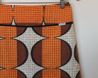 op art in orange and tan...ladies A line skirt in vintage cotton fabric