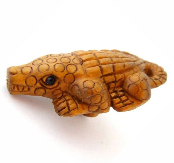 Ojime style hand carved alligator boxwood button from