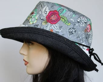Sunblocker UV summer sun hat with large wide brim featuring gray based floral print and adjustable fit
