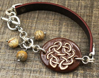 Celtic knot bracelet, brown earthtones ceramic leather, silver, picture jasper beads, 7 3/4 inches long