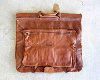 Vintage Garment Bag in Genuine Leather. Travel. Carry on. Circa 1960's.