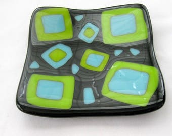 Neon Lights, black fused glass plate, lime blue