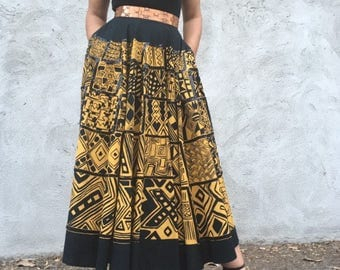 Gorgeous vintage black and yellow long skirt with abstract graphic tribal print s/m
