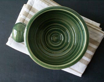 Stoneware shaving bowl glazed in forest green - hand thrown british pottery